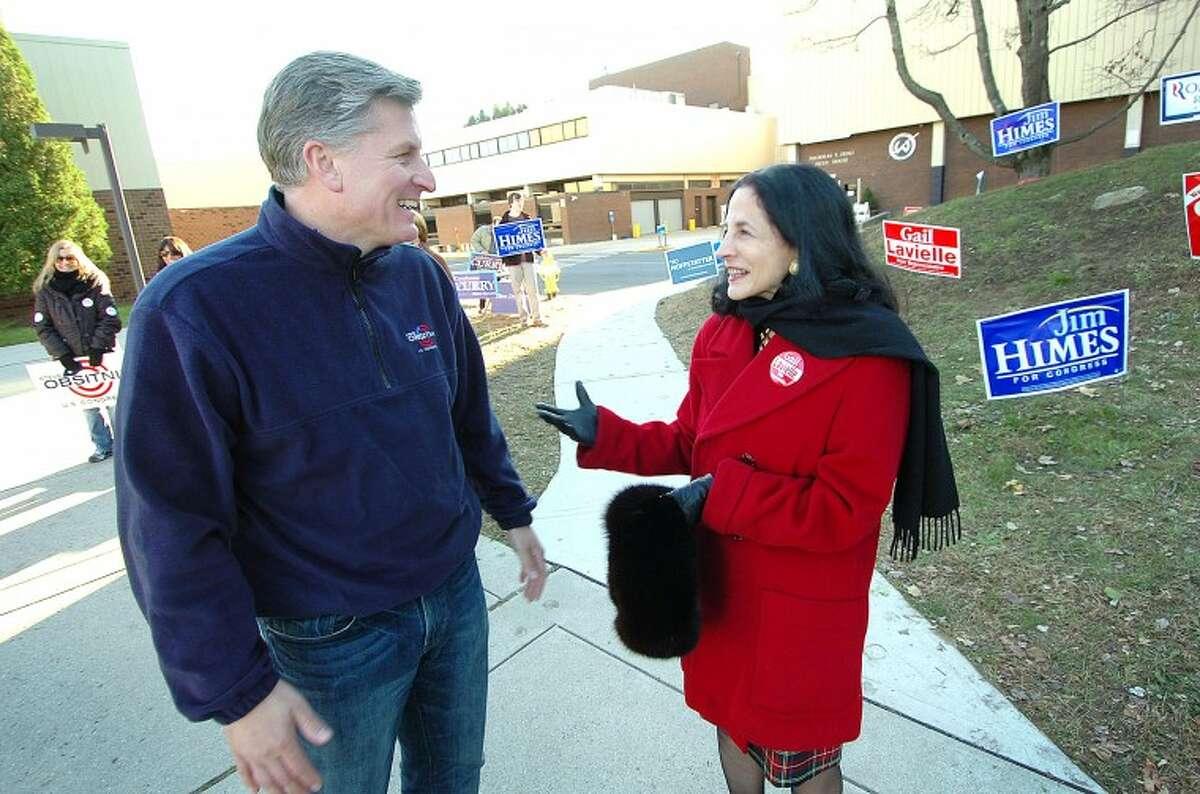 Hour Photo Alex von Kleydorff; Candidates Steve Obsitnik and Gail Lavielle greet voters at Wilton High School District 1 on Tuesday election day
