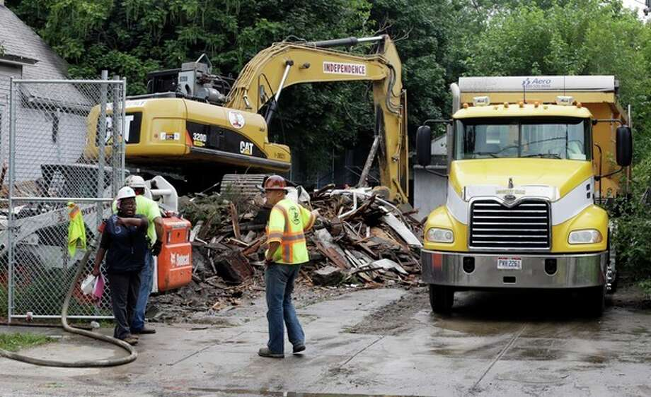 "The house where three women were held captive and raped for more than a decade is demolished, Wednesday, Aug. 7, 2013, in Cleveland. Authorities want to make sure the rubble isn't sold online as ""murderabilia,"" though no one died there. The house was torn down as part of a deal that spared Ariel Castro a possible death sentence. He was sentenced last week to life in prison plus 1,000 years. Castro apologized but blamed his addiction to pornography. (AP Photo/Tony Dejak) / AP"