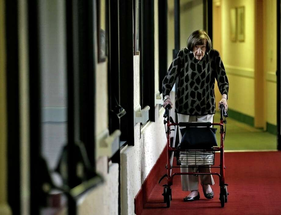 Selma Friedman, 102, makes her way through the corridors of her St. Andrew Estates South retirement community on her way to cast her vote early Tuesday, Nov. 6, 2012, in Boca Raton, Fla. Selma, originally from East Orange, N.J., first voted for Franklin Delano Rooosevelt in 1932. (AP Photo/Chris O'Meara) / AP