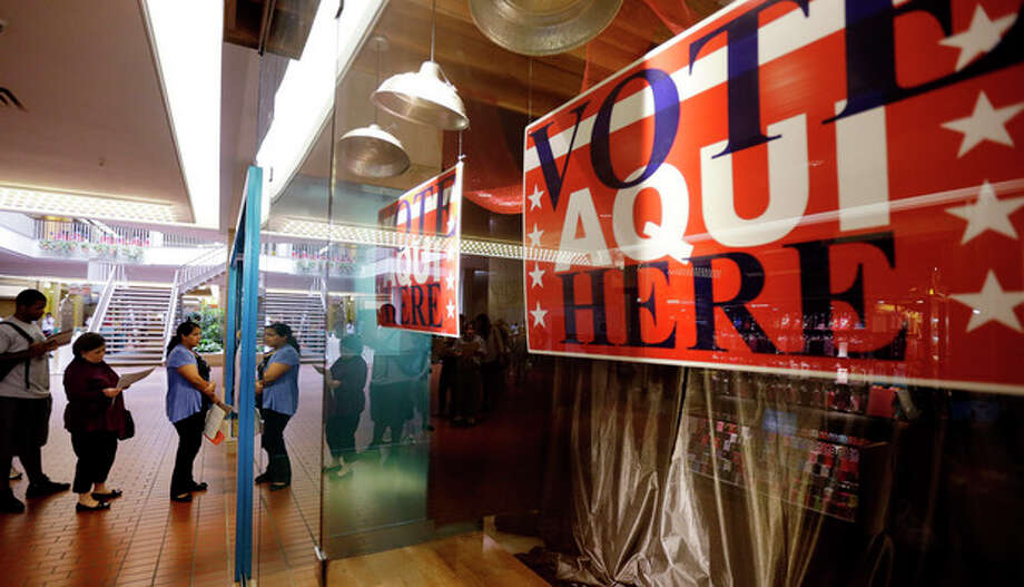 Voters wait in line at a polling place located inside a shopping mall on Election Day, Tuesday, Nov. 6, 2012, in Austin, Texas. (AP Photo/Eric Gay) / AP