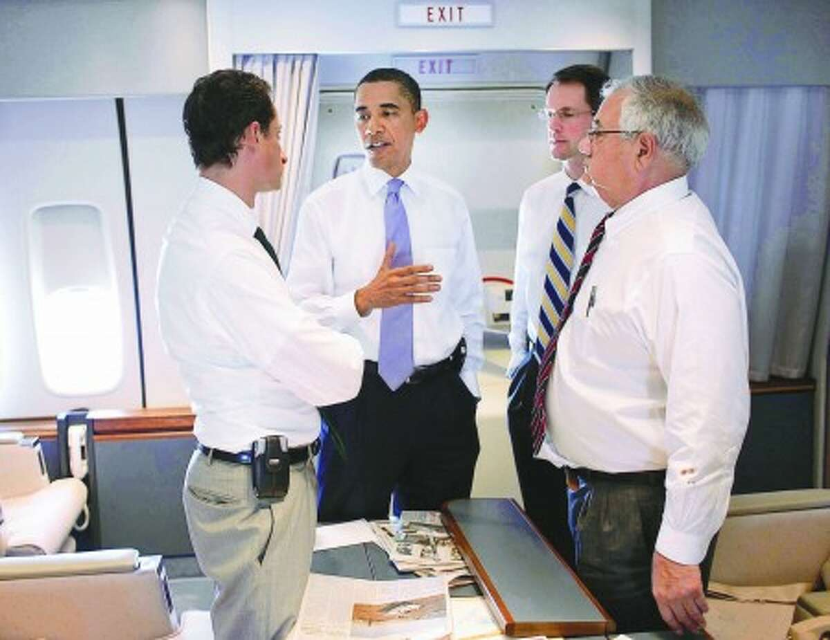 President Barack Obama talks with, from left, Rep. Anthony Weiner, D-NY, Rep. Jim Himes, D-CT, and Rep. Barney Frank, D-Ma., on Air Force One on the flight from JFK to Andrews Air Force Base, Monday, Sept. 14, 2009. (Official White House Photo by Pete Souza) This official White House photograph is being made available only for publication by news organizations and/or for personal use printing by the subject(s) of the photograph. The photograph may not be manipulated in any way and may not be used in commercial or political materials, advertisements, emails, products, promotions that in any way suggests approval or endorsement of the President, the First Family, or the White House.