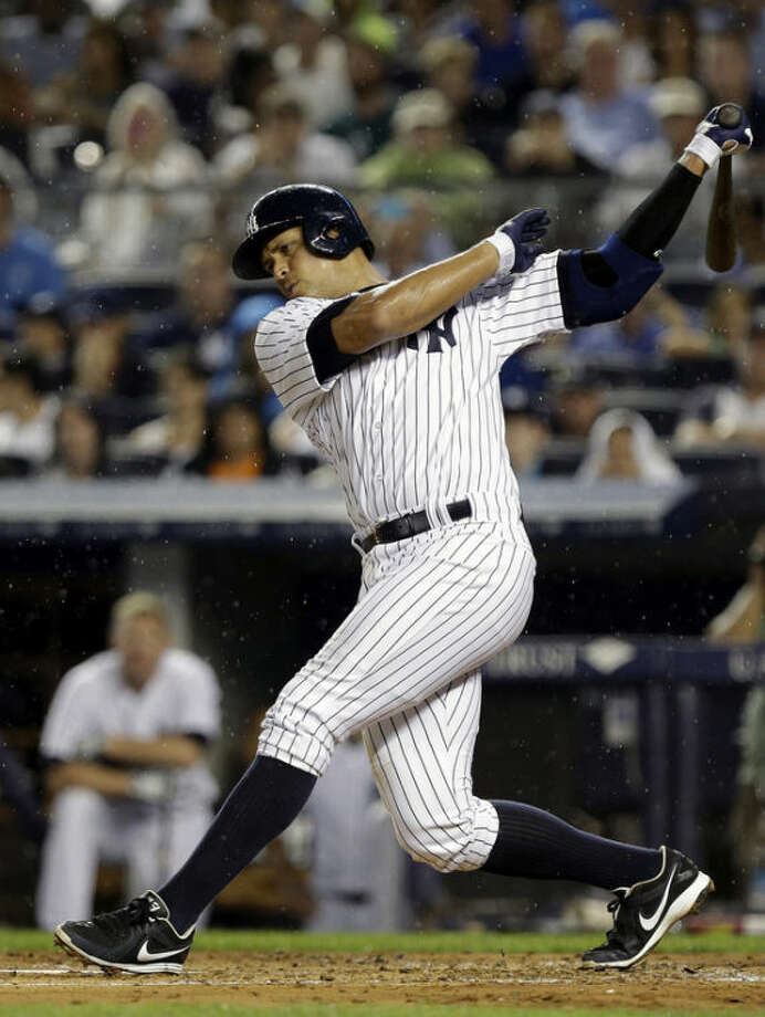 New York Yankees' Alex Rodriguez strikes out during his first at bat during the first inning of a baseball game against the Detroit Tigers on Friday, Aug. 9, 2013, in New York. (AP Photo/Frank Franklin II)