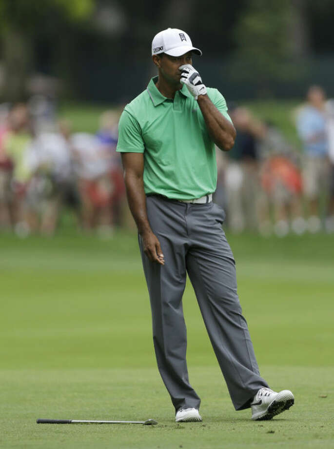 Tiger Woods reacts to a putt on the eighth hole during the second round of the PGA Championship golf tournament at Oak Hill Country Club, Friday, Aug. 9, 2013, in Pittsford, N.Y. (AP Photo/Julio Cortez)