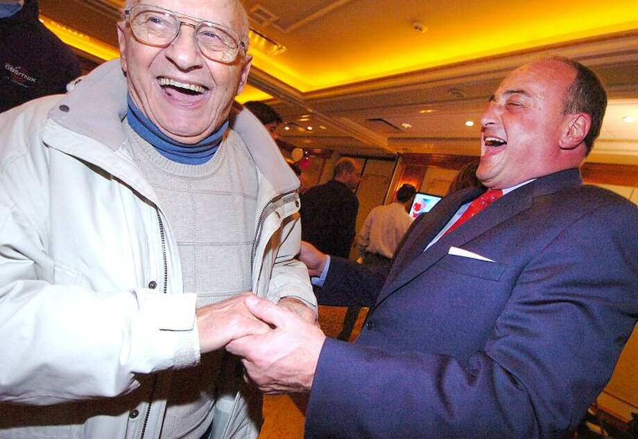 Hour Photo Alex von Kleydorff; Larry Cafero gets a congratulations and a hug from Former Norwalk Mayor Frank Esposito on election night at The Norwalk Inn and Conference Center