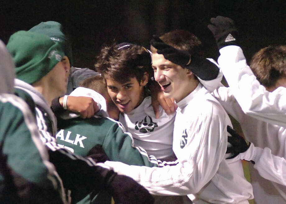 Hour photo/John NashNorwalk's Nacho Navarro, center, celebrates his goal that gave the Bears a three-goal lead in the second half of Tuesday's FCIAC co-championship game in Fairfield. The Bears avenged a regular-season loss by beating the Warriors, 5-1.