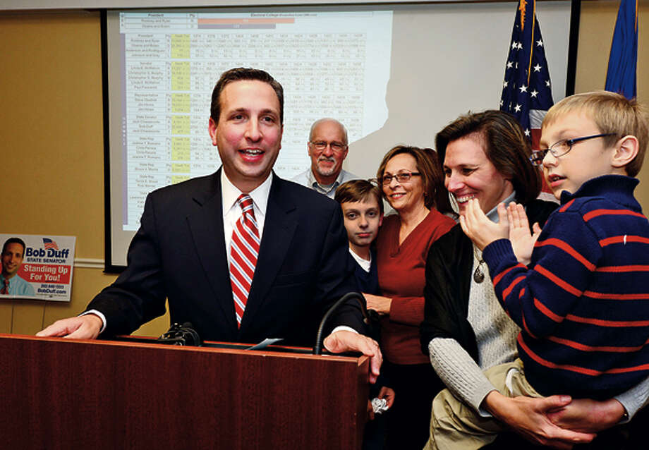State senator Bob Duff gives his victory speech surrounded by his family after winning reelection at the Hilton Garden Inn Tuesday night. Hour photo / Erik Trautmann / (C)2012, The Hour Newspapers, all rights reserved
