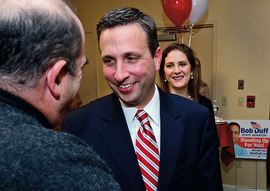 State senator Bob Duff receives congratulations after winning reelection at the Hilton Garden Inn Tuesday night. Hour photo / Erik Trautmann / (C)2012, The Hour Newspapers, all rights reserved