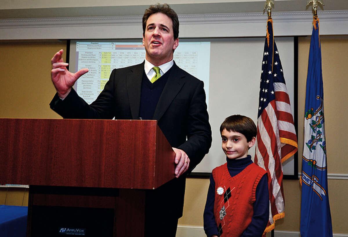 State representative Chris Perone gives his victory speech with his son Harrison at the Hilton Garden Inn Tuesday night. Hour photo / Erik Trautmann
