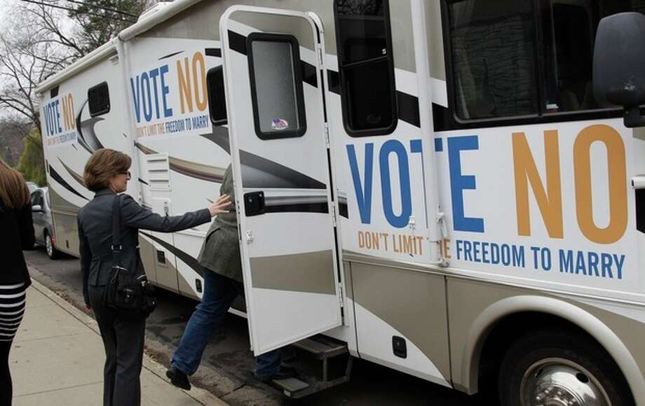 "State Auditor Rebecca Otto enters the RV at a stop in Edina, Minn., on the ""Minnesota Votes No"" statewide tour Monday, Nov. 5, 2012 in Minneapolis for the final day of the campaign to urge voters to vote against the marriage amendment. Candidates and volunteers worked Monday to make the most of their last 24 hours before decision day, hustling to energize their core supporters and searching for any remaining fence-sitters. Meanwhile, both political parties said they were gearing up like never before to watch the other for any electioneering on Tuesday. (AP Photo/Jim Mone) / AP"