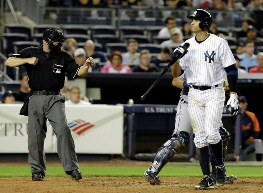 New York Yankees' Alex Rodriguez walks back to the dugout after striking out during the eighth inning of a baseball game against the Detroit Tigers Friday, Aug. 9, 2013, in New York. (AP Photo/Frank Franklin II) / AP