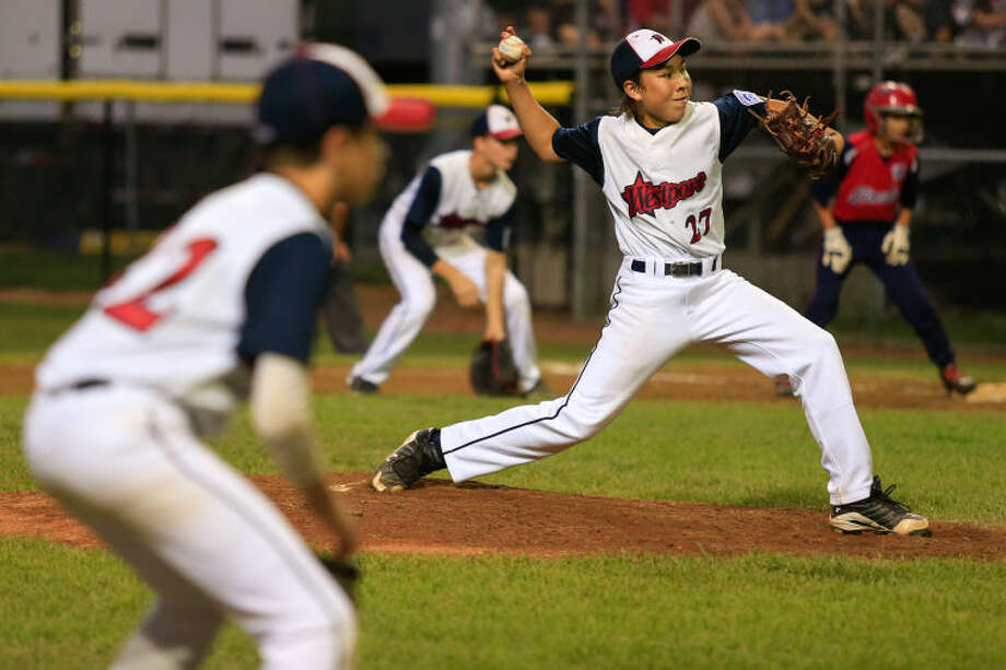 Westport's Chad Knight pitches in one of the final innings of Westport's 1-0 victory over Lincoln, R.I. in the Little League Baseball Eastern Regional State Championships on Saturday night at Giamatti Little League Field in Bristol, CT. (Hour Photo / Chris Palermo)