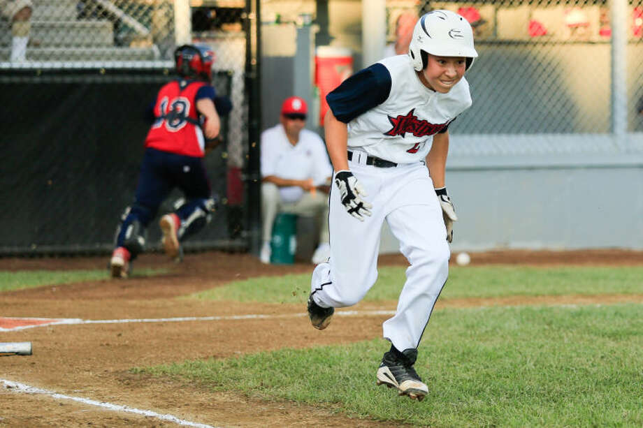 Wesport's Chad Kinght runs to first on a drop third strike during Westport's 1-0 victory over Lincoln, R.I. in the Little League Baseball Eastern Regional State Championships on Saturday night at Giamatti Little League Field in Bristol, CT. (Hour Photo / Chris Palermo)