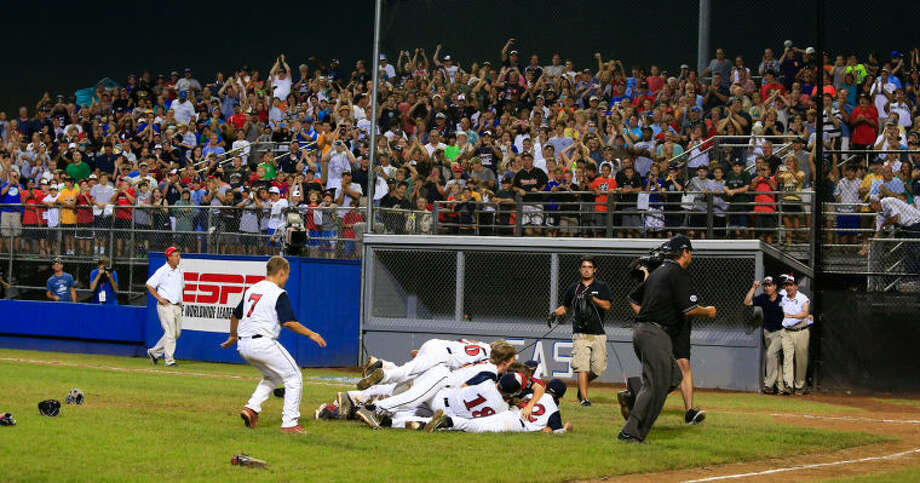 The Westport Little Leaguers celebrate their victory after the final out of Westport's 1-0 victory over Lincoln, R.I. in the Little League Baseball Eastern Regional State Championships on Saturday night at Giamatti Little League Field in Bristol, CT. (Hour Photo / Chris Palermo)