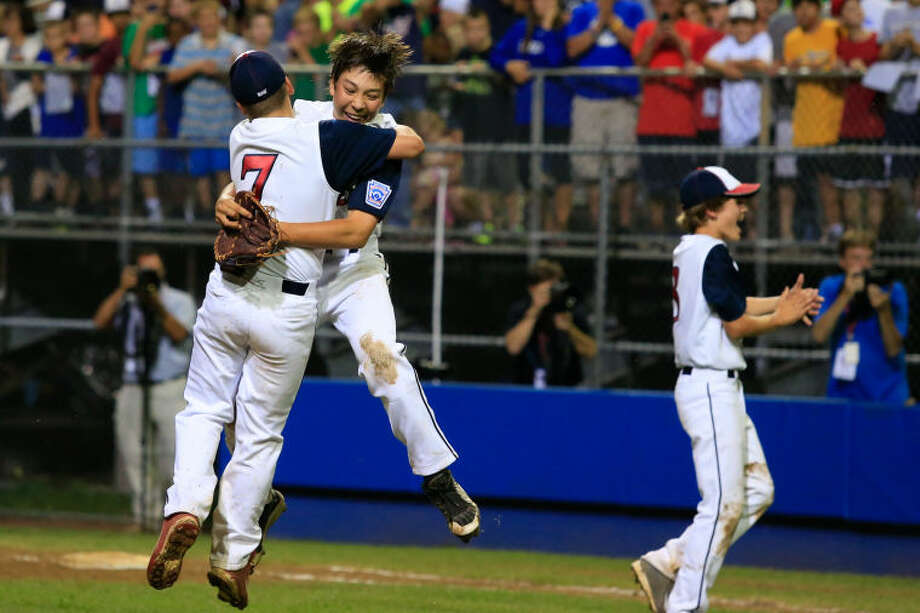 Westport's Pitcher Chad Kinght leaps to hug Charlie Roof after Westport's 1-0 victory over Lincoln, R.I. in the Little League Baseball Eastern Regional State Championships on Saturday night at Giamatti Little League Field in Bristol, CT. (Hour Photo / Chris Palermo)