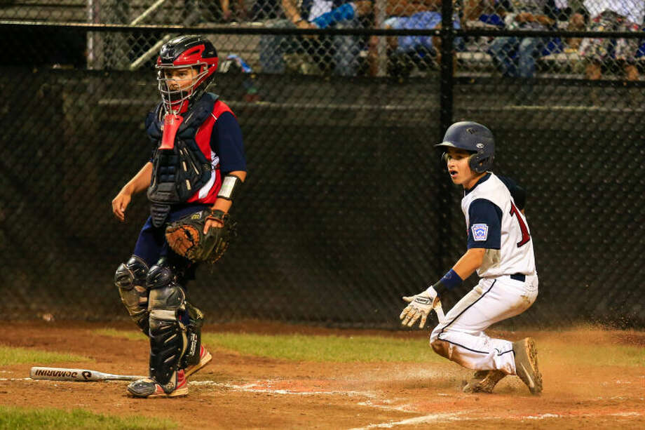 Westport's Ricky Offenberg scores the one and only run in the botton of the fifth inning during Westport's 1-0 victory over Lincoln, R.I. in the Little League Baseball Eastern Regional State Championships on Saturday night at Giamatti Little League Field in Bristol, CT. (Hour Photo / Chris Palermo)