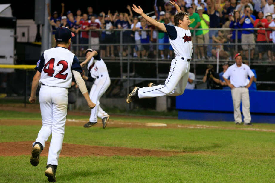 Westport's Pitcher Chad Knight leaps into the air after striking out the final batter during Westport's 1-0 victory over Lincoln, R.I. in the Little League Baseball Eastern Regional State Championships on Saturday night at Giamatti Little League Field in Bristol, CT. (Hour Photo / Chris Palermo)