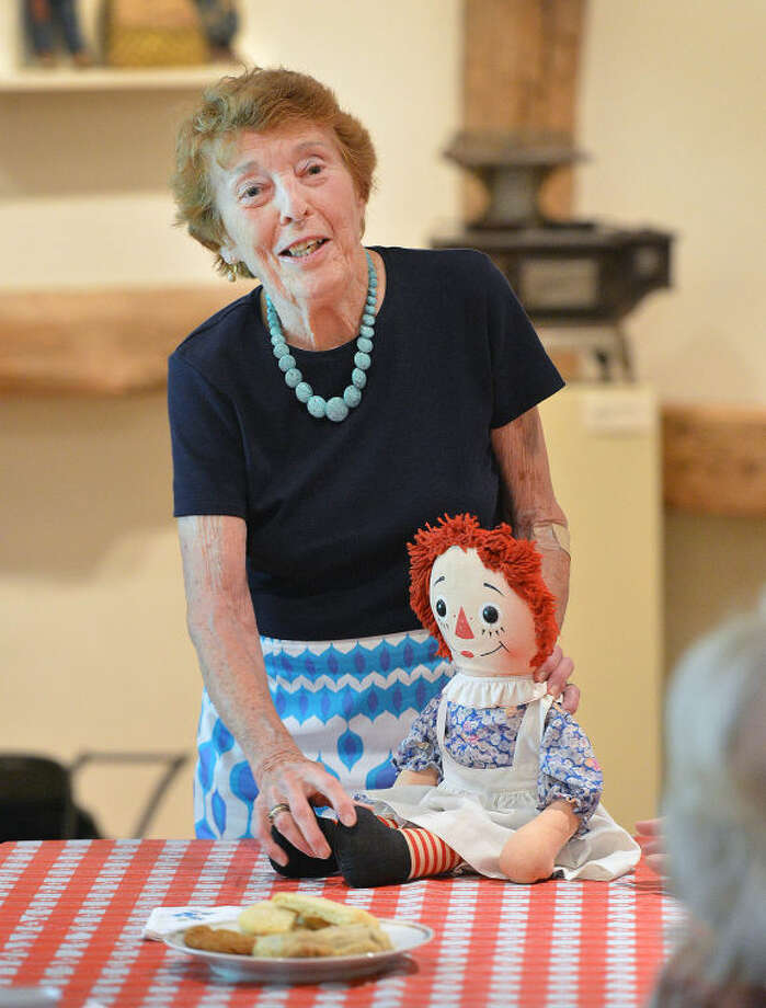 Hour Photo/Alex von Kleydorff. Emeritus Trustee and Original Toy Curator Mary Lou Logan talks about the dolls in the Society'scollection like the Ragedy Ann doll during a lunch program at The Wilton Historical Society.