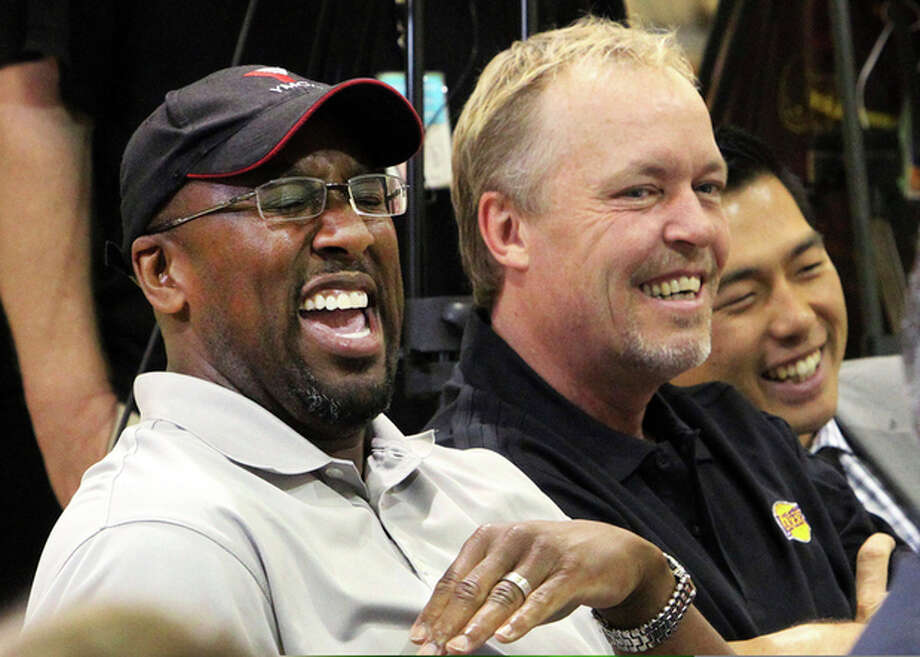 FILE - This July 11, 2012 file photo shows Los Angeles Lakers head coach Mike Brown, left, and owner Jim Buss laughing during a news conference at the basketball team's headquarters in El Segundo, Calif. A report from USA Today says the Lakers have fired Brown after a 1-4 start to his second season in charge of the team. The newspaper report Friday, Nov. 9, 2012 cited Brown's agent, Warren Legarie, as the source of the information. (AP Photo/Reed Saxon, file) / AP