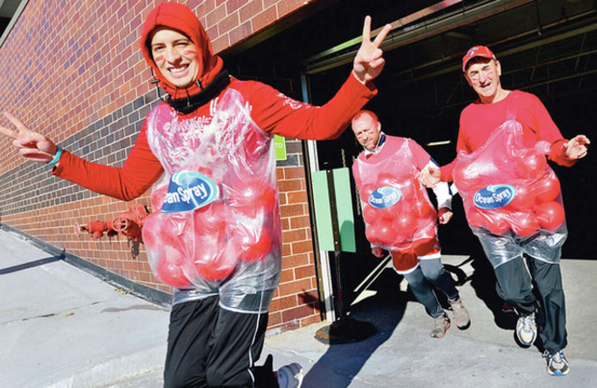 Employees with Reed Exhibition including Cindi DeNatale and the Saucy Cranberries team run their annual costumed 5K race from their offices on Main Ave. to benefit the Bridgeport Rescue Mission. Hour photo / Erik Trautmann