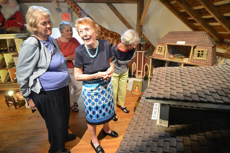 Hour Photo/Alex von Kleydorff. Emeritus Trustee and Original Toy Curator Mary Lou Logan takes a group on a tour of the Toy Loft and some of the dolls and doll houses at The Wilton Historical Society.