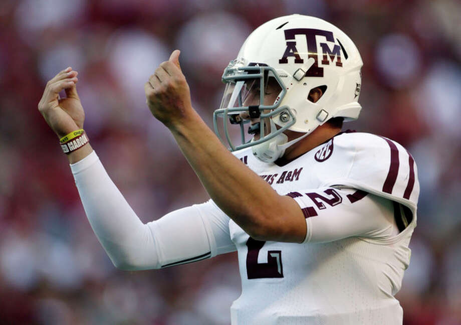 Texas A&M quarterback Johnny Manziel (2) reacts after the Aggies scored their third touchdown of the first quarter against Alabama during the first half of an NCAA college football game at Bryant-Denny Stadium in Tuscaloosa, Ala., Saturday, Nov. 10, 2012. (AP Photo/Dave Martin) / AP