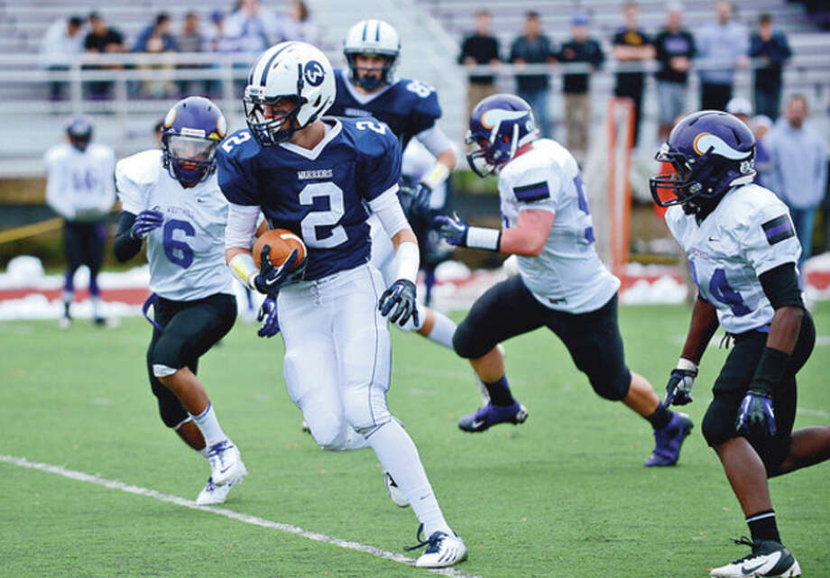 Hour photo/Erik TrautmannWilton's Zack Laurinatis runs for yardage during Saturday's game against Westhill in Stamford. The Vikings came from behind for a 41-28 victory. / (C)2012, The Hour Newspapers, all rights reserved