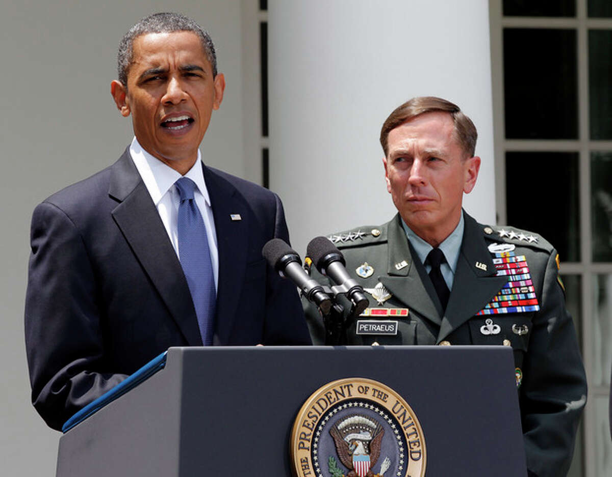 FILE - In this June 23, 2010 file photo, President Barack Obama, accompanied by Gen. David Petraeus, announces that Petraeus would replace Gen. Stanley McChrystal, from the Rose Garden of the White House in Washington. Petraeus, the retired four-star general who led the U.S. military campaigns in Iraq and Afghanistan, resigned Friday, Nov. 9, 2012 as director of the CIA after admitting he had an extramarital affair. (AP Photo/J. Scott Applewhite, File)