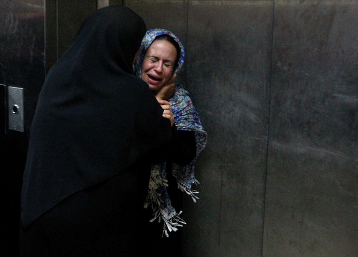 AP photo A Palestinian woman cries at a hospital in Gaza City, Saturday. An explosion targeted an Israeli military vehicle on Jewish state?•s border with Gaza on Saturday and Israeli troops fired into the Palestinian territory, killing several civilians and wounding at least 25, Gaza officials and witnesses said.