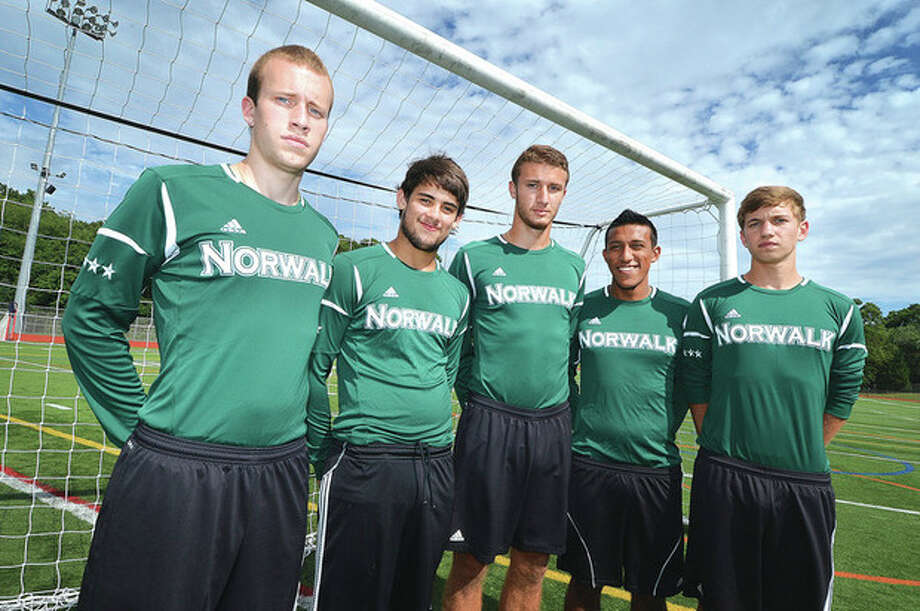 Hour photo/Alex von KleydorffNorwalk High's 2012 state championship soccer team was made up of a wide array of talented players. For many of them, their days on the pitch will continue on the next level with eight of the former Bears planning to play in college. Included in that talented group are, from left, Paul Soja, Nacho Navarro, Andrew Melitsanopoulos, Santiago Muriel and Michal Nowicki. / © 2013 The Hour Newspapers