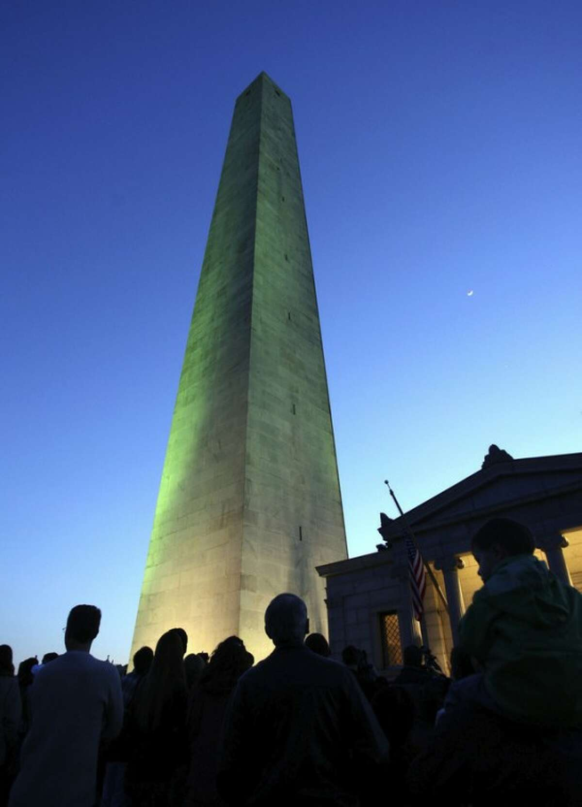 FILE - In a Friday, April 20, 2007 file photo, the upper portion and main shaft of the 221-foot tall Bunker Hill Monument is illuminated, in Charlestown, Mass. Boston's Battle of Bunker Hill monument didn't get built until the 1840s. As Americans gather at war memorials, battle monuments and military cemeteries to honor veterans, Niagara University history professor Thomas Chambers points out that such places were belatedly established for the soldiers who fought in the nation's earliest wars. (AP Photo/Mary Schwalm, File)