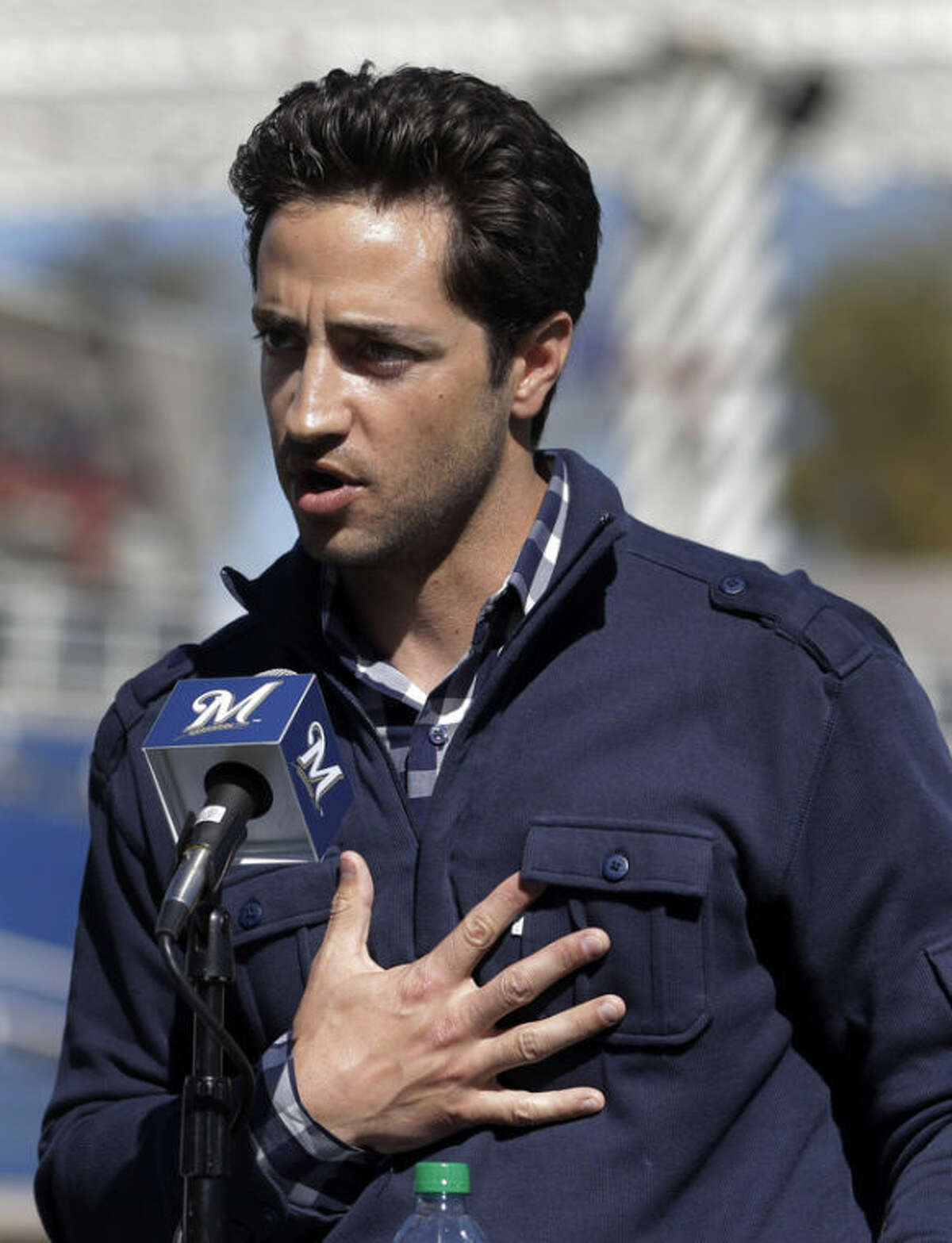 FILE - In this Feb. 24, 2012 file photo, Milwaukee Brewers' Ryan Braun speaks during a news conference at spring training baseball in Phoenix. Braun stood on a spring training field and proclaimed he was innocent of using banned testosterone. Braun has finally admitted taking performance-enhancing drugs during his NL MVP season of 2011. The suspended Milwaukee slugger said in a statement released Thursday, Aug. 22, 2013, by the Brewers that he took a cream and a lozenge containing banned substances while rehabilitating an injury. (AP Photo/Jae C. Hong, File)