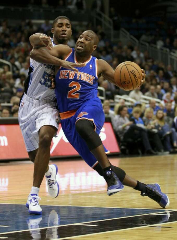 New York Knicks' Raymond Felton (2) drives past Orlando Magic's E'Twaun Moore (55) during the first half of an NBA basketball game, Tuesday, Nov. 13, 2012, in Orlando, Fla. (AP Photo/John Raoux)