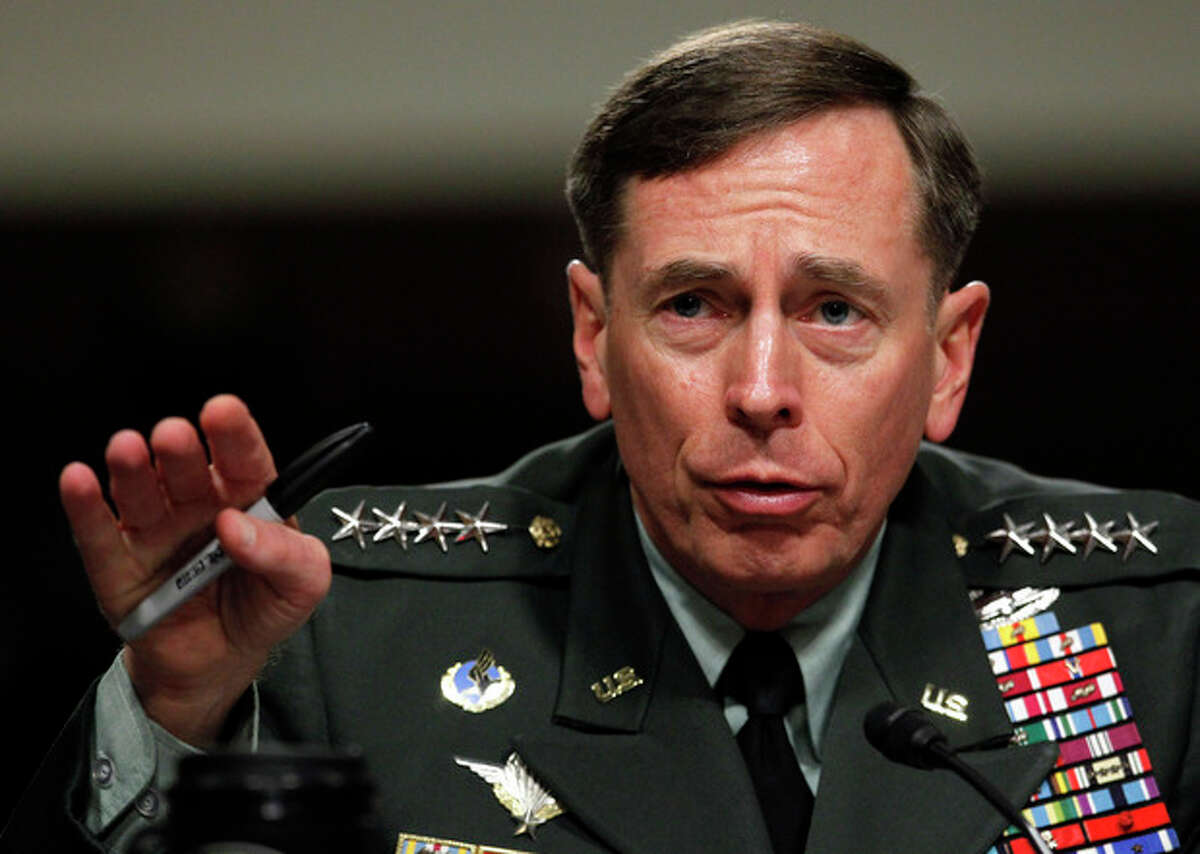 FILE - In this June 29, 2012 file photo, Gen. David Petraeus testifies before the Senate Armed Services Committee on Capitol Hill in Washington. Petraeus, the retired four-star general who led the U.S. military campaigns in Iraq and Afghanistan, resigned Friday, Nov. 9, 2012 as director of the CIA after admitting he had an extramarital affair. (AP Photo/Pablo Martinez Monsivais, File)