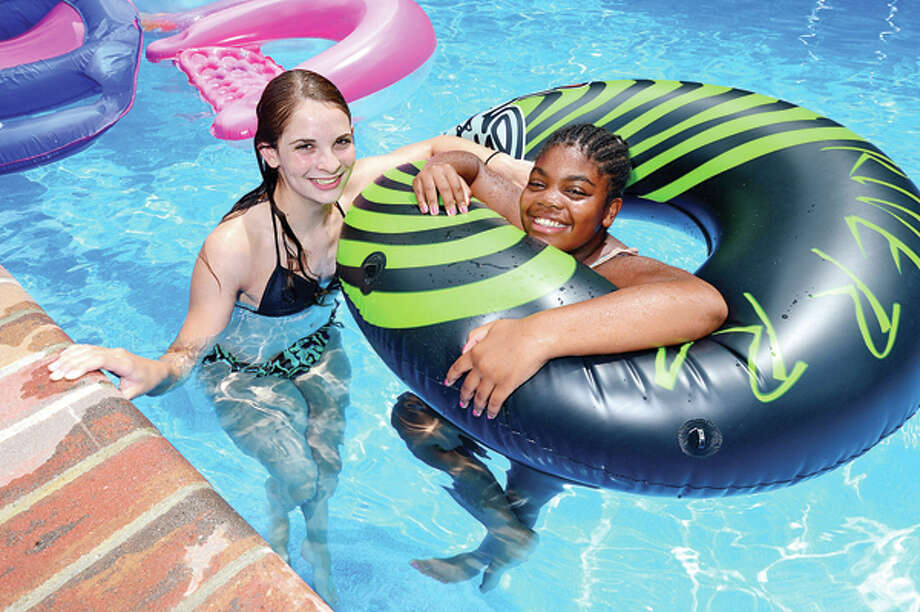 Kim Devine 15 and her Fresh Air Fund visitor Cyrah Thomas use the pool as one of their favorite activites during Thomas' stay recently. Hour photo / Erik Trautmann / (C)2013, The Hour Newspapers, all rights reserved