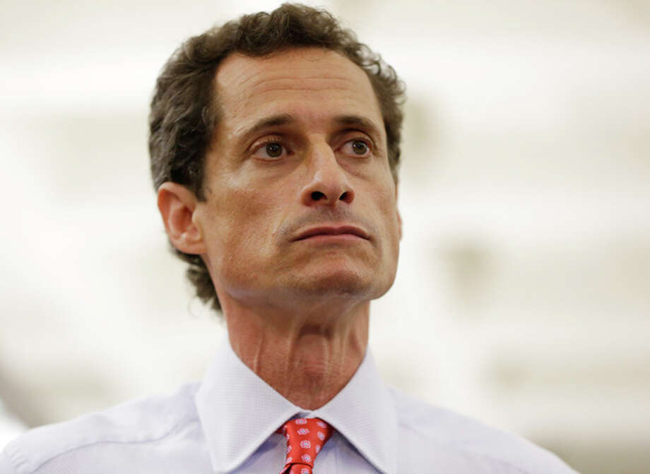 New York City Mayoral candidate Anthony Weiner takes reporters questions during a news conference at the Gay Men's Health Crisis headquarters, Tuesday, July 23, 2013, in New York. The former congressman says he's not dropping out of the New York City mayoral race in light of newly revealed explicit online correspondence with a young woman. (AP Photo/Kathy Willens) / AP