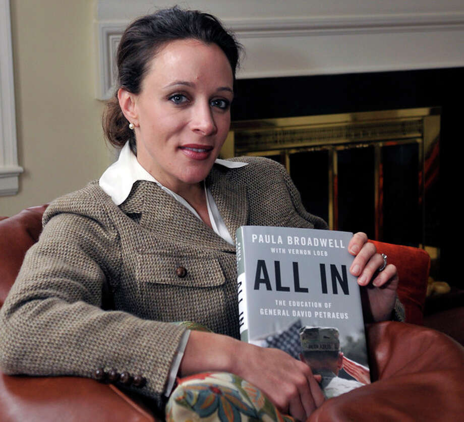 """In this Jan. 15, 2012 photo, Paula Broadwell, author of the David Petraeus biography """"All In,"""" poses for photos in Charlotte, N.C. Petraeus, the retired four-star general renowned for taking charge of the military campaigns in Iraq and then Afghanistan, abruptly resigned Friday, Nov. 9, 2012 as director of the CIA, admitting to an extramarital affair. Petraeus carried on the affair with Broadwell, according to several U.S. officials with knowledge of the situation. (AP Photo/The Charlotte Observer, T. Ortega Gaines) LOCAL TV OUT (WSOC, WBTV, WCNC, WCCB); LOCAL PRINT OUT (CHARLOTTE BUSINESS JOURNAL, CREATIVE LOAFLING, CHARLOTTE WEEKLY, MECHLENBURG TIMES, CHARLOTTE MAGAZINE, CHARLOTTE PARENTS) LOCAL RADIO OUT (WBT) / The Charlotte Observer"""