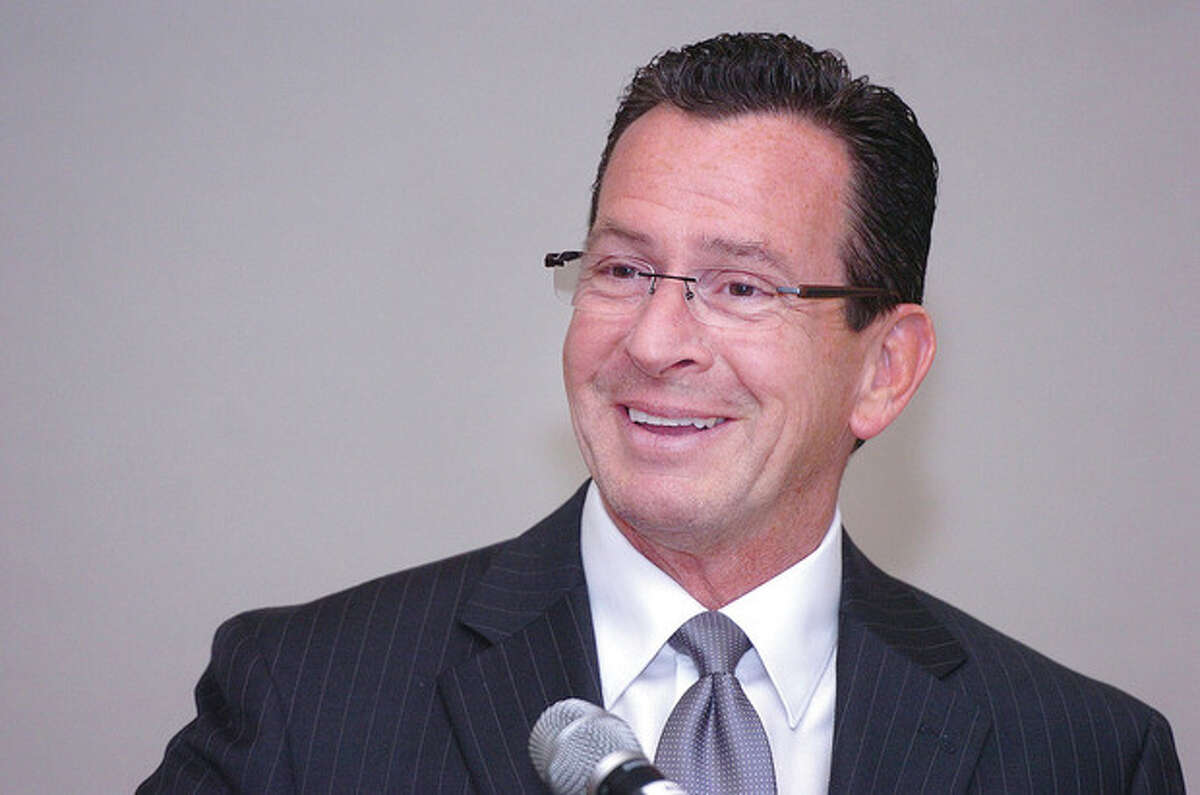 Hour Photo Alex von Kleydorff; Governor Dannel Malloy has the Wilton Chamber laughing as the Keynote speaker at their annual dinner at Rolling Hills Country Club.