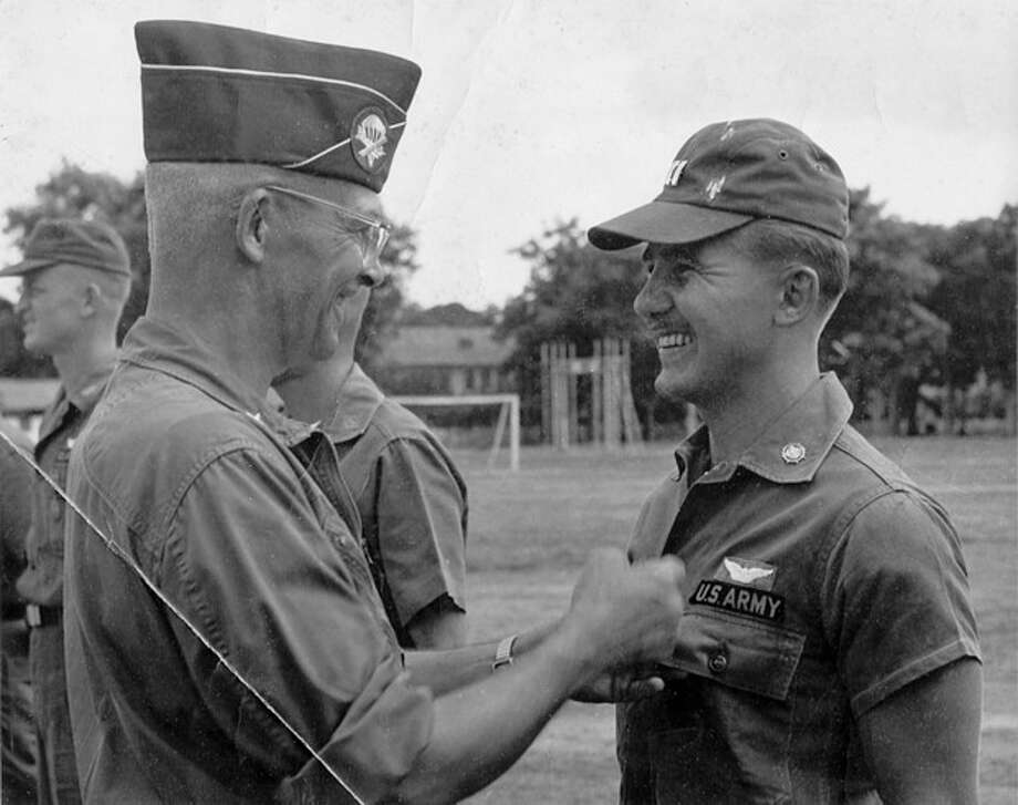 "ADVANCE FOR USE SUNDAY, NOV. 11, 2012 AND THEREAFTER - In this 1963 photo from the U.S. Army, Gen. Joseph Stilwell Jr. awards Richard Olsen with the Air Medal at Bien Hoa, South Vietnam. Olsen moved beyond Vietnam to an artistic career that has spanned more than 50 years; he's produced more than 1,000 paintings, many of them abstract. His work has been shown in galleries around the country. Yet those days when he flew his chopper over the dense thicket of jungle maintain a deep hold on him. ""War is the depth of the human experience,"" he says. ""It's the most meaningful part of anyone's life."" (AP Photo/U.S. Army) / U.S. Army"