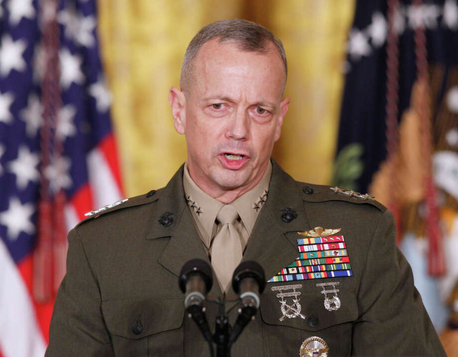 Ap file photosIn an April 28, 2011 file photo Marine Corps Lt. Gen. John Allen, at left, speaks in the East Room of the White House in Washington. The sex scandal that led to CIA Director David Petraeus, at left, downfall widened Tuesday with word the top U.S. commander in Afghanistan is under investigation for thousands of emails. / AP