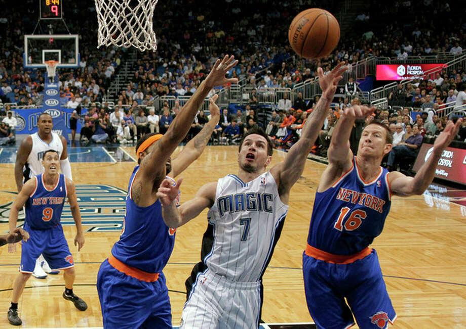 Orlando Magic's J.J. Redick (7) goes up for a shot between New York Knicks' Steve Novak (16) and Rasheed Wallace, left, during the first half of an NBA basketball game, Tuesday, Nov. 13, 2012, in Orlando, Fla. (AP Photo/John Raoux) / AP