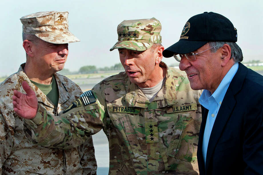 FILE POOL - In this July 9, 2011 file photo, USMC Gen. John Allen, left, and Army Gen. David Petraeus, top U.S. commander in Afghanistan and incoming CIA Director, greet former CIA Director and new U.S. Defense Secretary Leon Panetta, right, as he lands in Kabul, Afghanistan, Saturday, July 9, 2011. (AP Photo/Paul J. Richards, Pool) / AFP POOL