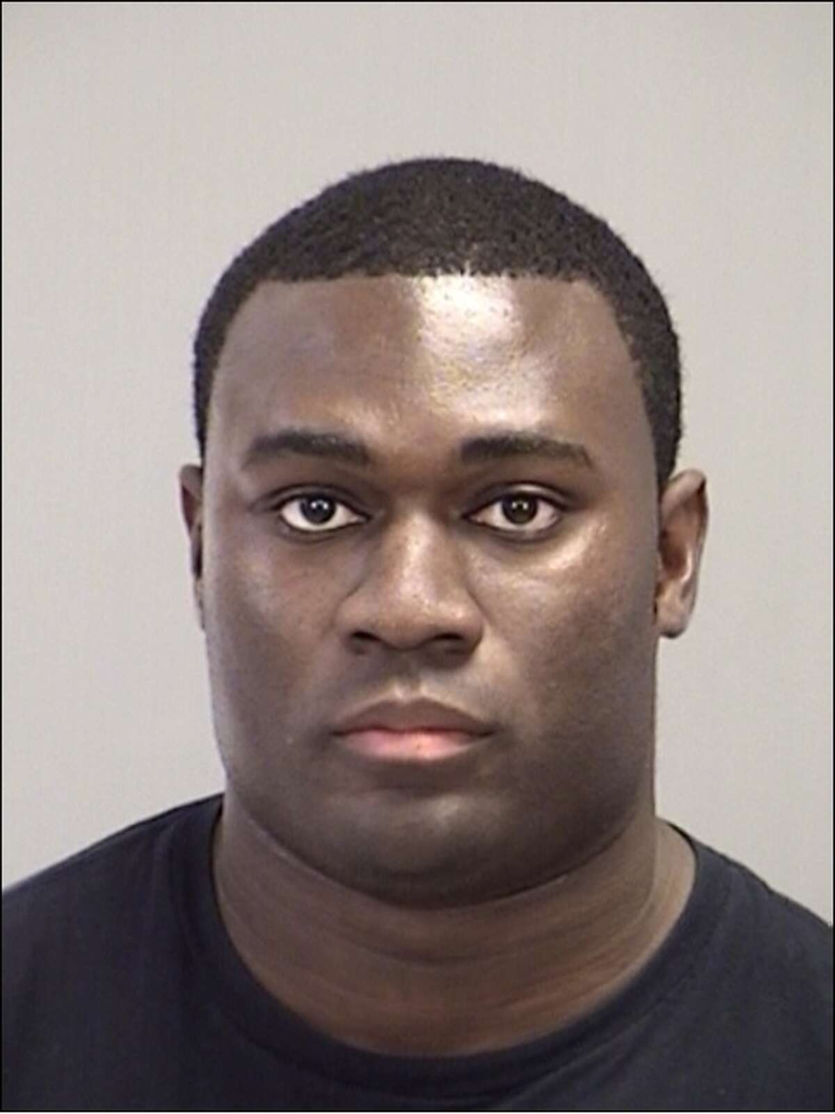 Folushayo Michael Gaiusbayode, 29, was arrested Tuesday morning and charged with two counts of impersonating a peace officer, a class B misdemeanor, according to Brazos County Jail records.