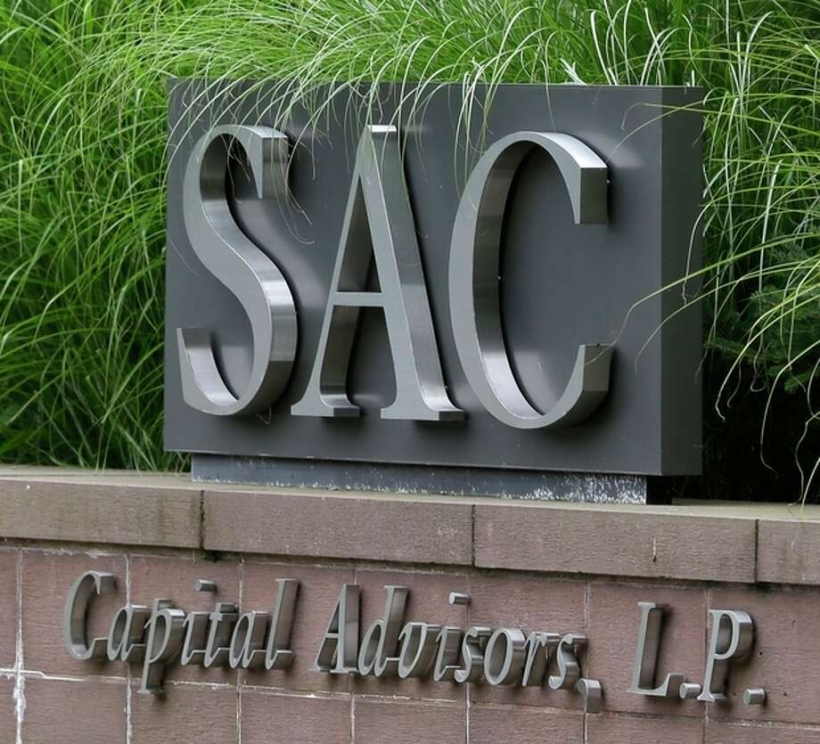 A sign is displayed in front of SAC Capital Advisors headquarters in Stamford, Conn., Thursday, July 25, 2013. The hedge fund operated by embattled billionaire Steven A. Cohen was hit with white-collar criminal charges Thursday that accused the fund of making hundreds of millions of dollars illegally, and a related government lawsuit said insider trading was pervasive and unprecedented at the firm. (AP Photo/Seth Wenig) / AP