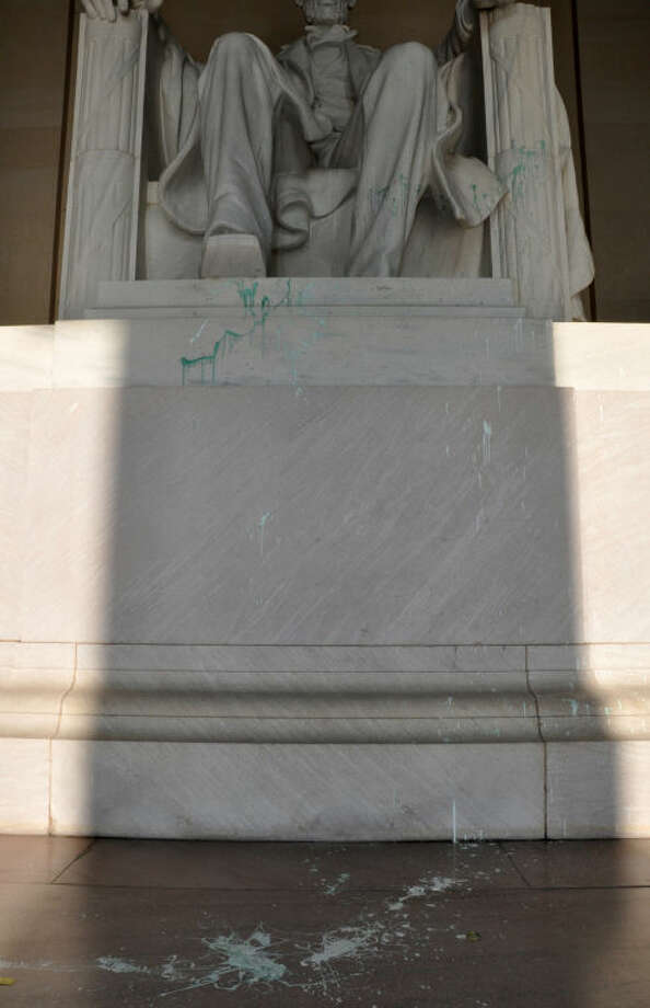 This handout photo provided by the National Park Service shows green paint splatter on the Lincoln Memorial in Washington, Friday, July 26, 2013. The Lincoln Memorial was temporarily closed Friday after someone splattered a splash of green paint on the statue. The apparent vandalism was discovered around 1:30 a.m. Friday on the statue, the pedestal and the floor, U.S. Park Police said. No words, letters or symbols were visible in the paint. (AP Photo/National Park Service)
