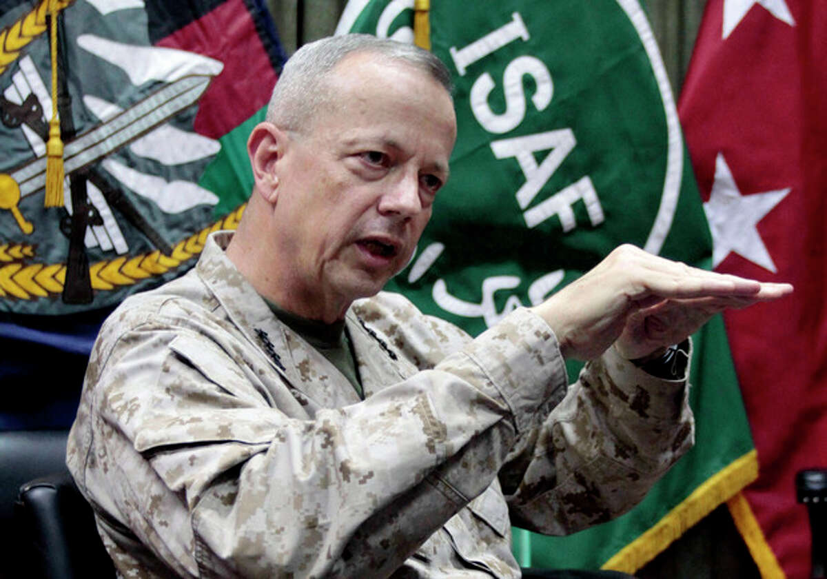 """FILE - This July 22, 2012, file photo shows U.S. Gen. John Allen, top commander of the NATO-led International Security Assistance Forces (ISAF) and U.S. forces in Afghanistan, during an interview with The Associated Press in Kabul, Afghanistan. The Pentagon says Gen. John Allen is under investigation for alleged """"inappropriate communications"""" with Jill Kelley, the woman who is said to have received threatening emails from Paula Broadwell, the woman with whom former CIA Director David Petraeus had an extramarital affair. Defense Secretary Leon Panetta says the FBI referred the matter to the Pentagon on Sunday, Nov. 11, 2012. Panetta says he ordered a Pentagon investigation of Allen on Monday. (AP Photo/Musadeq Sadeq, File)"""