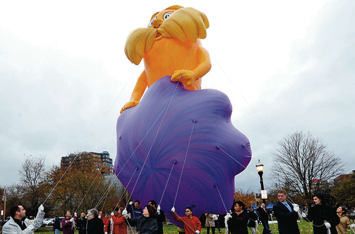 The balloon handler training session for volunteers in Latham Park Tuesday for Stamford's upcoming 2012 UBS Parade Spectacular . Hour photo / Erik Trautmann