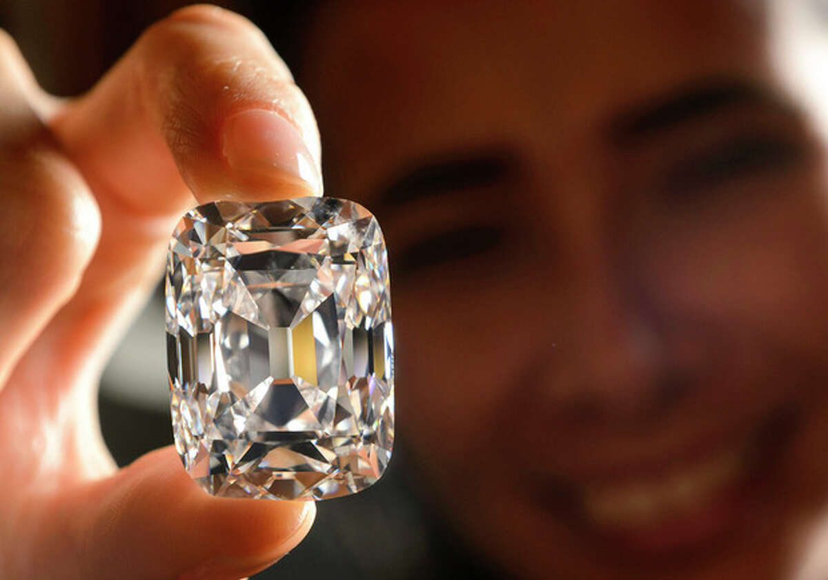FILE- In this Oct. 4, 2012, file photo, a model holds the Archduke Joseph Diamond, a historical diamond, during a Christie's auction preview, in Geneva, Switzerland. On Tuesday, Nov. 13, 2012 Christie?'s is selling the Archduke Joseph Diamond, one of the rarest and most famous. The 76.02 carat diamond, with perfect color and internally flawless clarity, came from the ancient Golconda mines in India. It is expected to sell for more than $15 million. In 1993, Christie?'s auctioned it in Geneva where it sold for $ 6.5 million. (AP Photo/Keystone, Laurent Gillieron, File)