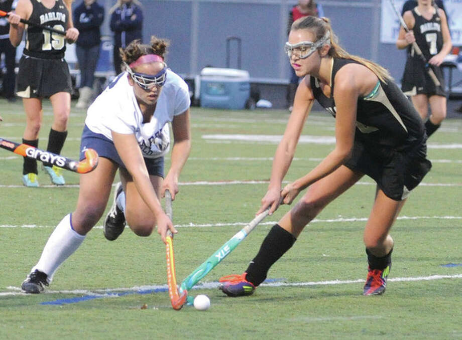 Hour photo/Matthew VinciWilton's Madison Hendry, left, tries to get around Joel Barlow's Whitney Carter as they battle during Monday's Class L state tournament field hockey game in Wilton. Hendry had two goals in the top-seeded Warriors' 3-0 victory. / (C)2011 {your name}, all rights reserved