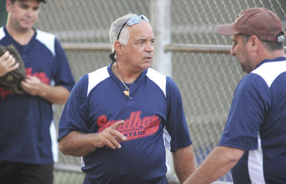 Hour photo/John NashSteve Annunziato, left, talks to one of his players during Wednesday's Mimi Lawrence Wood Bat League game at Calf Pasture. Annunziato has put together a group of veteran players who may be long in the tooth but not short of enthusiasm when it comes to slowpitch softball.