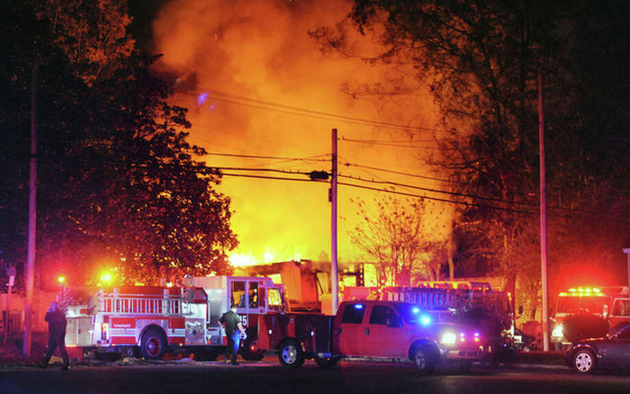 Flames and smoke billow from a home in west Jackson, Miss., Tuesday evening, Nov. 13, 2012, after authorities say a small plane carrying three people crashed into the residence shortly after 5 p.m. (AP Photo/The Clarion-Ledger, Joe Ellis) NO SALES / The Clarion-Ledger